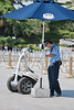 A policeman checks on his tricked-out segway in Beijing's Tiananmen Square. (07/26/11, 2:55:44 PM)