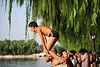 A swimmer prepares to dive into Beijing's Houhai Lake on a hot July afternoon. (07/26/11, 5:19:17 PM)