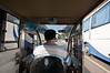 A Beijing moto-cab driver threads his way between a pair of busses. (07/26/11 3:22:46 PM)