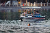 Boaters and a swimmer in Beijing's Houhai Lake. (07/26/11, 5:17:47 PM)