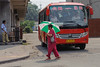 A Luoyang woman finds herself serendipitously color coordinated with a bus. (Chanhe, Luoyang, Henan, CN - 07/11/11, 10:50:16 AM)