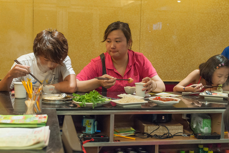 People dine in a Luoyang Hot Pot restaurant. (Luoyang, Henan, CN - 07/10/11, 7:49:23 PM)