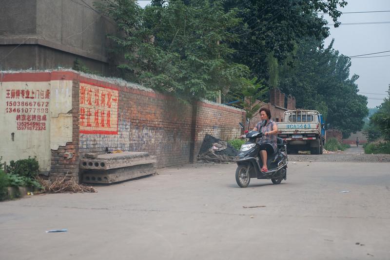 A Local Enters Ta Zhuang Village (Yanshi, Luoyang, Henan, CN - 07/12/11, 11:40:29 AM)