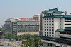 The Beijing Civil Aviation Building (left) stands in contrast to the Prime Hotel (right) and its stylized Ming-influenced rooftop (Dongcheng, Beijing, CN - 07/11/12, 11:34:30 AM)