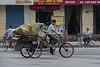 A man pedals a heavy load on an Anyang street (Anyang Shi, Henan Sheng, CN - 07/15/16, 1:16:32 PM)