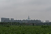 A cluster of new apartment houses represents the current northern line of demarcation between urban and rural Anyang. (Anyang Shi, Henan Sheng, CN - 07/15/16, 10:48:07 AM)