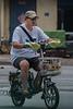 A man rides a moped in Anyang. (Anyang Shi, Henan Sheng, CN - 07/15/16, 1:16:05 PM)