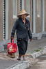 A worker leaves a shop in a just-completed development of stores and restaurants designed to attract tourism to the Anyang Yinxu Museum. (Anyang Shi, Henan Sheng, CN - 07/15/16, 1:05:50 PM)