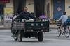A man lounges in the back of a motorized cart. (Anyang Shi, Henan Sheng, CN - 07/15/16, 1:16:26 PM)