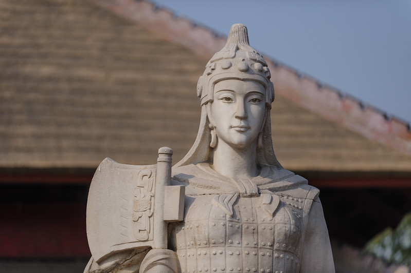 A statue of the Shang dynasty warrior-queen Fu Hao stands in front of her excavated tomb at the Yinxu Shang Dynasy Archaeology site and museum. (Yindu, Anyang, Henan, CN - 10/26/13, 11:08:11 AM)