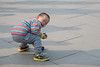 A youngster demonstrates his radio-controlled race car in the plaza of Anyang's National Museum of Chinese Writing. (Anyang, Henan, CN - 10/26/13, 2:52:09 PM)
