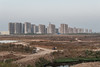 A new highrise apartment complex under construction on the far outskirts of Anyang appears to rise like a mirage in the middle of nowhere. (Anyang, Henan, CN - 10/24/13, 5:14:02 PM)