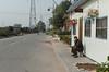 A man relaxes with his birds in Xioatun Village. (Yindu, Anyang, Henan, CN - 10/26/13, 11:54:18 AM)