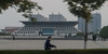 A cyclist rides past the Anyang City Museum. (Wenfeng, Anyang, Henan, CN - 10/24/13, 5:32:07 PM)
