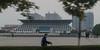 A cyclist rides past the Anyang City Museum. (Wenfeng, Anyang, Henan, CN - 10/24/13, 5:32:07 PM)