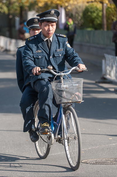 Two Beijing police officers share a bike. (Shichahai, Xicheng, Beijing, CN - 11/14/13, 1:40:04 PM)