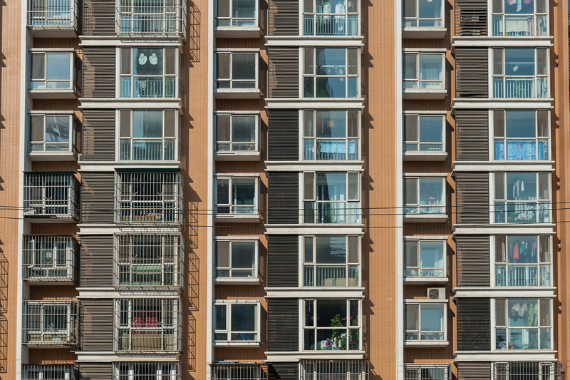 A residential highrise takes on an almost surreal appearance when viewed without context. (Gongzhufen, Fengtai, Beijing, CN - 10/24/13, 1:34:51 PM)