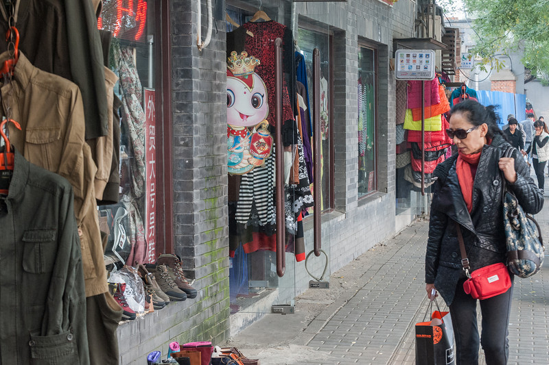A woman window shops in Beijing. (Xicheng, Beijing, CN - 10/22/13, 2:24:45 PM)