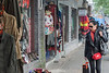 A woman window shops in Beijing. (Xicheng, Beijing, CN - 10/22/13, 2:24:45 PM)