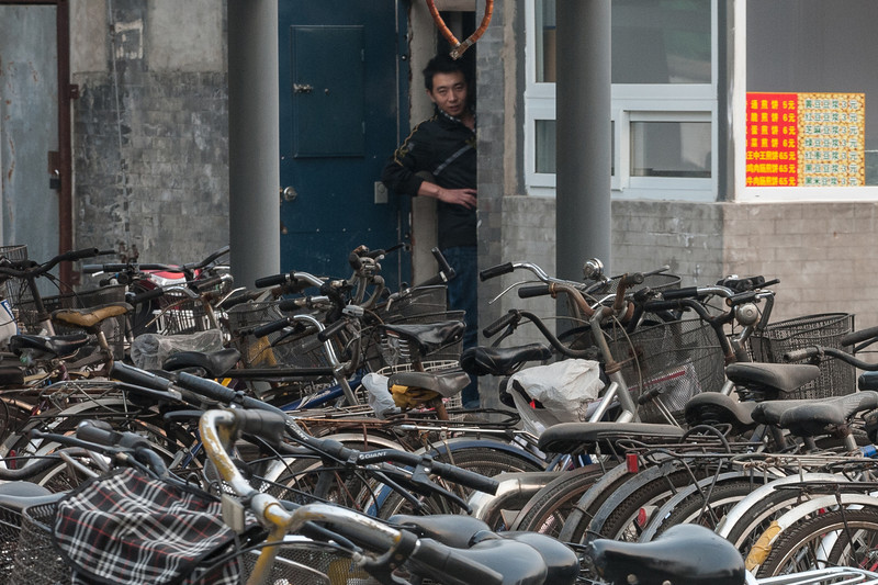 A Beijing bicycle parking lot attendant - and his attendant bicycles. (Dongcheng, Beijing, CN - 10/22/13, 2:46:29 PM)