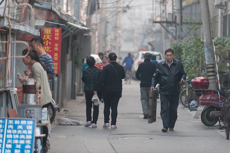 Beijingers stroll near the entrance to a hutong. (Dongcheng, Beijing, CN - 10/22/13, 9:05:05 AM)