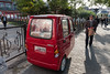 A very narrow three-wheeled vehicle is parked on a Beijing sidewalk. (Xicheng, Beijing, CN - 10/23/13, 3:15:05 PM)