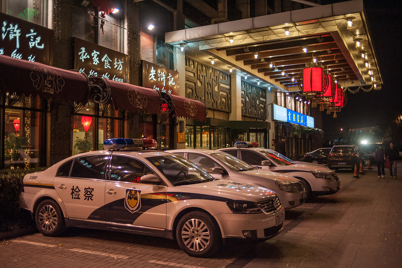 Beijing police cars parked in front of a Wangfujing Street restaurant. (Dongcheng, Beijing, CN - 10/23/13, 9:17:14 PM)