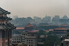 Looking west from the Dongcheng district (foreground) past the Sun Dongan Shopping Center and it's stylized imperial multi-inclined roof (left), the Forbidden City (center) and the Xicheng district (background) are visible through the Beijing smog. (07/09/15, 1:32:46 PM)