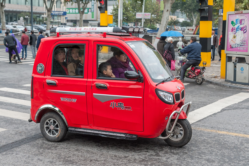 This miniature three-wheeled vehicle seats a family of five comfortably... for about a minute. (Beiguan Qu, Anyang Shi, Henan Sheng, CN - 10/23/16, 3:52:56 PM)