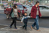 A young boy purses his lips while walking with his parents along an Anyang sidwealk. (Beiguan Qu, Anyang Shi, Henan Sheng, CN - 10/24/16, 10:25:06 AM)