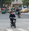 A man rides his scooter through an Anyang intersection. (Beiguan Qu, Anyang Shi, Henan Sheng, CN - 10/23/16, 4:39:30 PM)