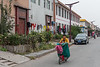 A woman and her child ride a scooter down Xiaotun Village's main street. (Yindu Qu, Anyang Shi, Henan Sheng, CN - 10/24/16, 11:37:18 AM)
