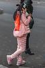 A girl in pink eats a yam. (Beiguan Qu, Anyang Shi, Henan Sheng, CN - 10/23/16, 4:50:09 PM)