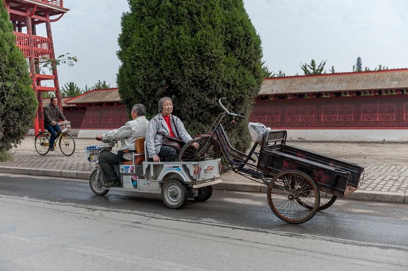 An Anyang couple haul a pedal-wagon in their motorized cart. (Yindu Qu, Anyang Shi, Henan Sheng, CN - 10/24/16, 11:04:10 AM)