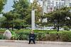 An old-timer sits solemnly on an Anyang sidewalk. (Beiguan Qu, Anyang Shi, Henan Sheng, CN - 10/23/16, 3:30:42 PM)
