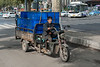 A man yawns while hauling goods on his motorized cart on an Anyang street. (Beiguan Qu, Anyang Shi, Henan Sheng, CN - 10/24/16, 10:25:14 AM)