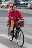 A woman and her daughter bicycle through an Anyang intersection. (Beiguan Qu, Anyang Shi, Henan Sheng, CN - 10/23/16, 4:38:18 PM)
