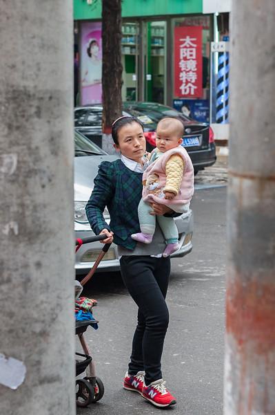 A mother and her baby walk along an Anyang street. (Beiguan Qu, Anyang Shi, Henan Sheng, CN - 10/23/16, 3:39:22 PM)