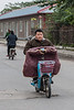 A man rides his scooter on the main street of Xiaotun Village. (Yindu Qu, Anyang Shi, Henan Sheng, CN - 10/24/16, 11:40:45 AM)