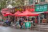 A man on a moped surveys goods for sale on an Anyang street. (Beiguan Qu, Anyang Shi, Henan Sheng, CN - 10/23/16, 3:45:50 PM)