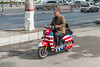 A man drives his American flag-emblazoned scooter on an Anyang street. (Beiguan Qu, Anyang Shi, Henan Sheng, CN - 10/24/16, 10:23:01 AM)