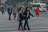 Two young women walk arm-in-arm in a central Anyang crosswalk. (Beiguan Qu, Anyang Shi, Henan Sheng, CN - 10/26/16, 4:42:27 PM)