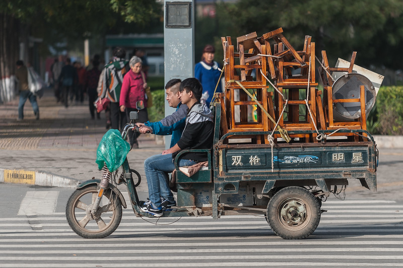 Two men haul chairs in their motorized cart in central Anyang. (Beiguan Qu, Anyang Shi, Henan Sheng, CN - 10/25/16, 2:48:04 PM)