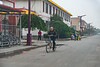 A man rides his bike on the main street of Anyang's Xiaotun Village. (Yindu Qu, Anyang Shi, Henan Sheng, CN - 10/26/16, 4:15:59 PM)
