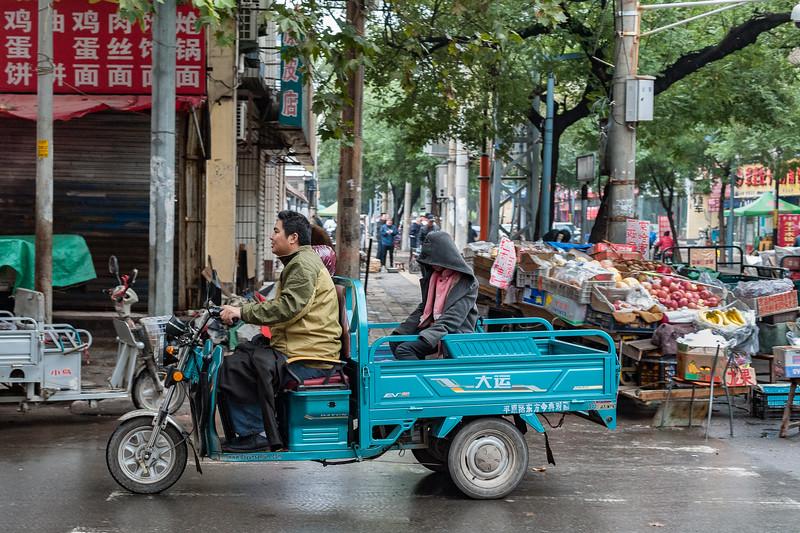 Residents ride their motorized cart on an Anyang street. (Beiguan Qu, Anyang Shi, Henan Sheng, CN - 10/23/16, 3:45:46 PM)
