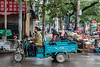 Residents ride their motorized cart on an Anyang street. (Beiguan Qu, Anyang Shi, Henan Sheng, CN - 10/23/16, 3:45:46 PM)