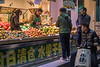 Customers peruse fruit at a Dongdan Street produce shop. (Dongcheng Qu, Beijing, CN - 11/01/16, 5:45:35 PM)