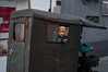 A boy smiles through the window of a vhicle as it drives into the entrance of a Beijing hutong. (Dongcheng Qu, Beijing, CN - 11/01/16, 5:23:08 PM)