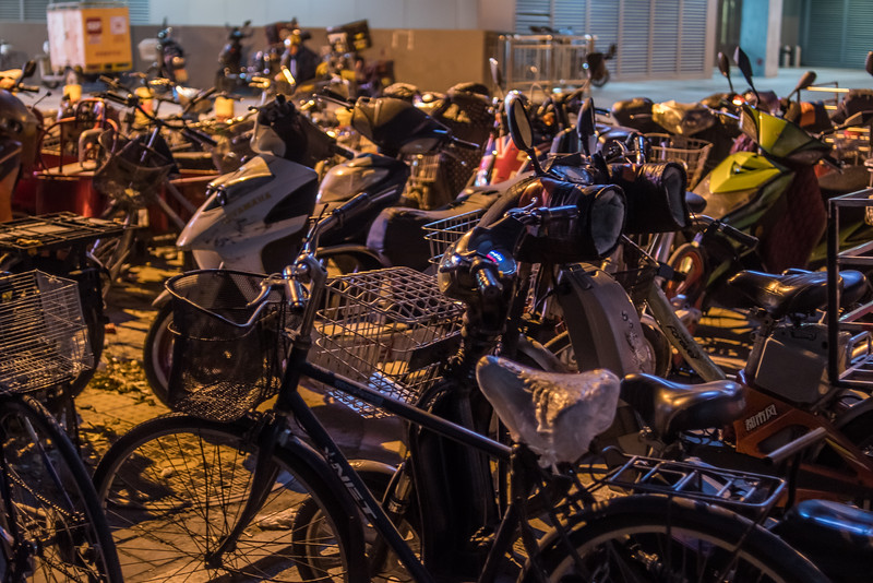 Bicycles are parked in a pen on a Dongcheng district sidewalk. (Dongcheng Qu, Beijing, CN - 11/01/16, 9:20:57 PM)