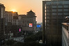 The sun sets over Beijing's Xindong'an department store, with its stylized pagoda-like rooftop.. The large building on the right is the new Waldorf Astoria hotel. (Dongcheng Qu, Beijing, CN - 11/01/16, 4:34:22 PM)